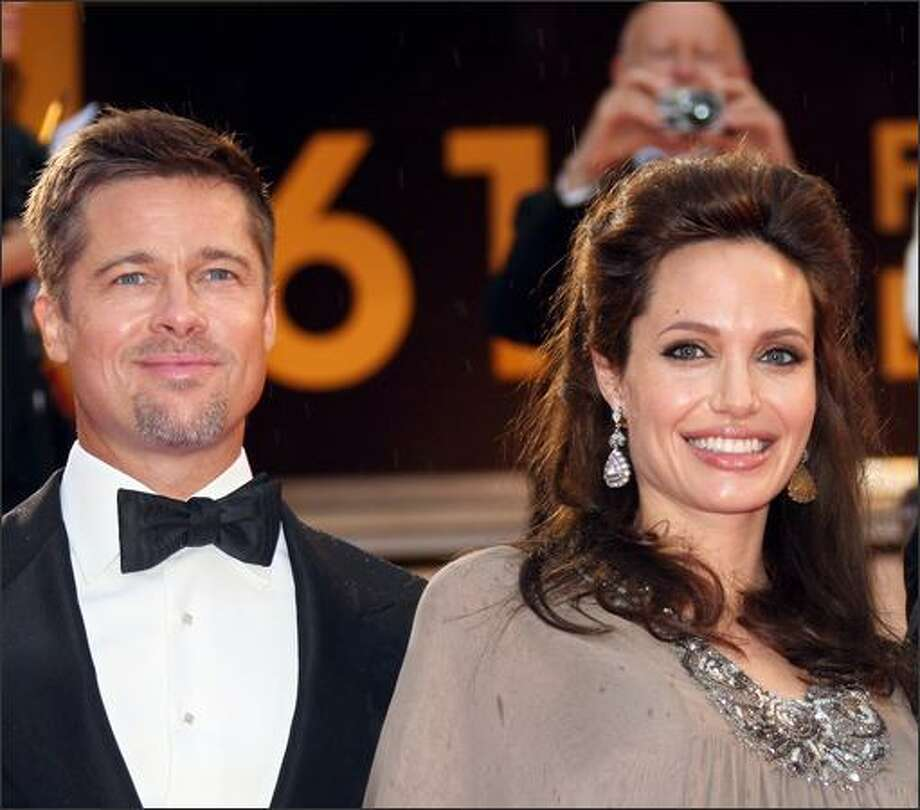 "Brad Pitt and Angelina Jolie arrive at  the screening of  Clint Eastwood's film ""The Changeling"" Tuesday at Cannes. Photo: Getty Images / Getty Images"