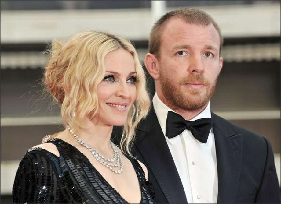 """Madonna and her husband, British director Guy Richie, arrive at the screening of Nathan Rissman's film """"I Am Beacuse We Are"""" at the 61st Cannes International Film Festival on Wednesday. Photo: Getty Images / Getty Images"""