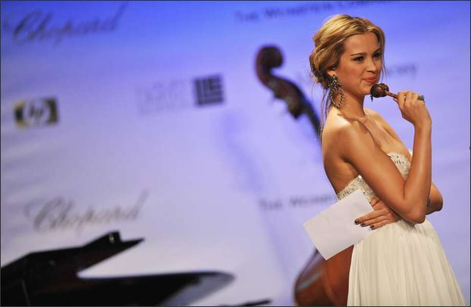 Model Petra Nemcova speaks on stage during the amfAR's Cinema Against AIDS 2008 benefit held at Le Moulin de Mougins during the 61st International Cannes Film Festival on May 22, 2008 in Cannes, France. Photo: Getty Images / Getty Images
