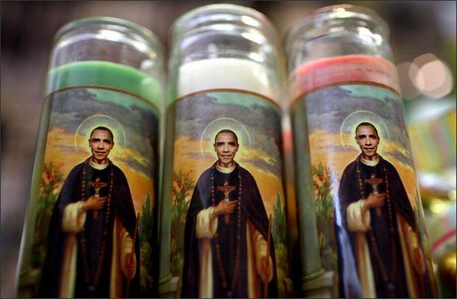 """An image of U.S. President Barack Obama depicted as a saint is seen on 10-inch-tall votive candles displayed at the """"Just For Fun"""" store March 2 in San Francisco. The candles, created by Johnny Oliver, angered members of the St. Philip the Apostle Church who saw them as mocking Christ. The store """"Just For Fun"""" had sold over 1,000 of the votives at $12.95 each but had yet to sell one of the two-foot-tall candles, which go for $395. Photo: Getty Images / Getty Images"""