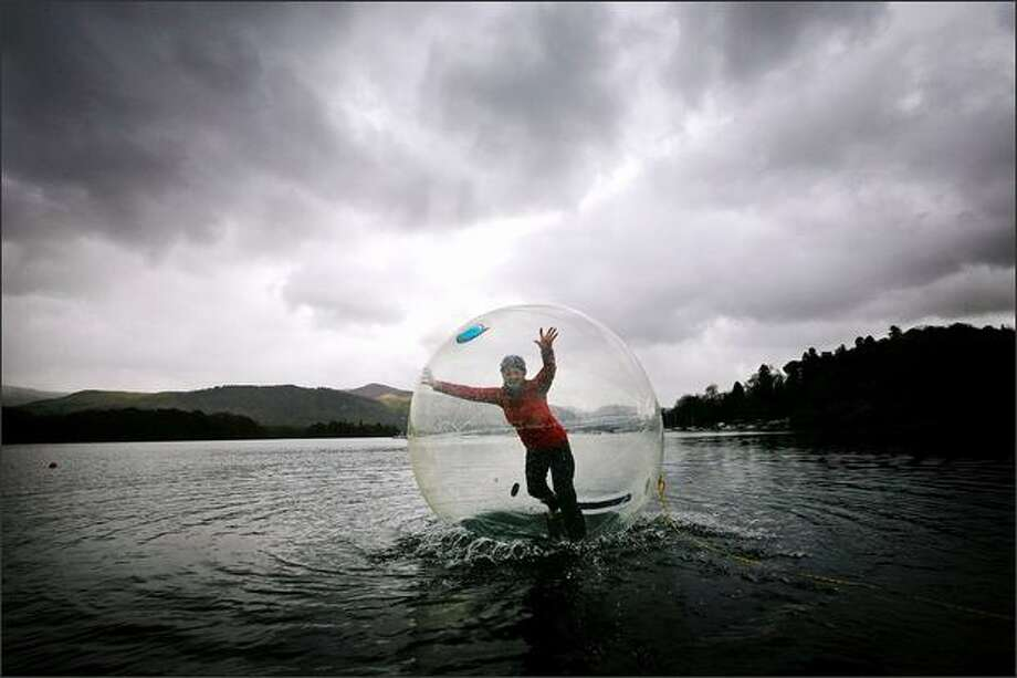 Keswick Mountain Festival volunteer Tara Vallente walks on water inside an inflatable sphere on Derwent Water in the Lake District in Keswick, England. The new floating adventure is one of the hundreds of activities available to the public as part of this year's Mountain Festival, which starts on May 13. Photo: Getty Images / Getty Images