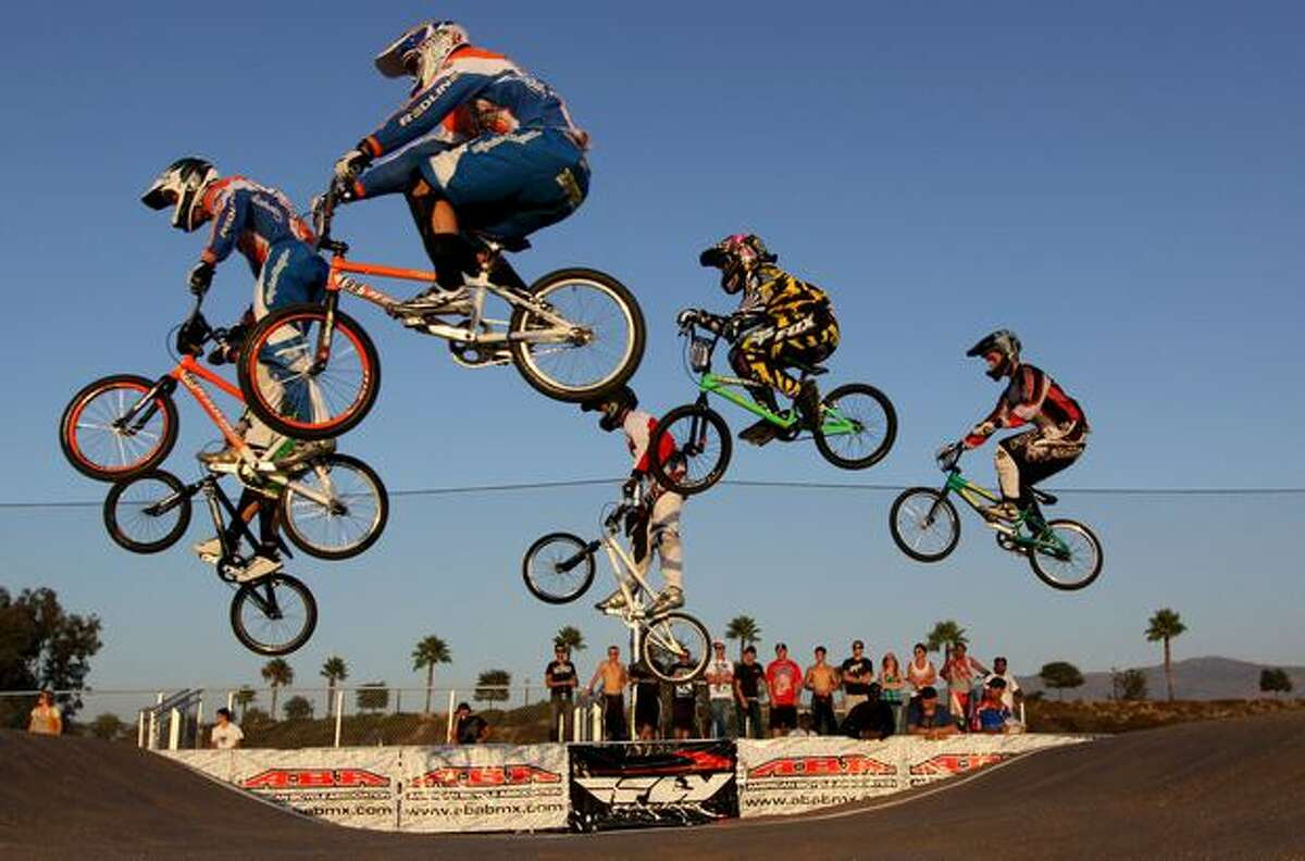 BMX racers catch air during a race during the UCI BMX Supercross 2009 in Chula Vista, California.