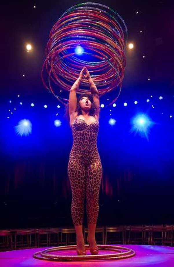 "Hula hoop artist 'Marawa' performs during a photocall to promote the ""La Clique"" Cabaret in London. Photo: Getty Images / Getty Images"