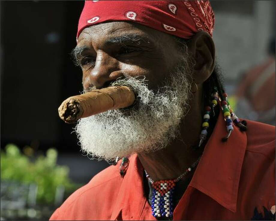 "Cuban Jose Manuel Soto, better known as ""El Gran Taita,"" prepares to smoke a cigar in Old Havana. Soto is a retired seaman and a follower of Argentine-Cuban guerrilla leader Ernesto ""Che"" Guevara. Photo: Getty Images / Getty Images"