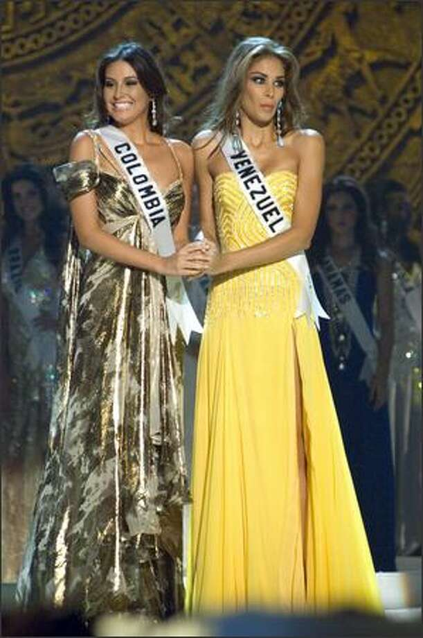 Taliana Vargas, Miss Colombia, and Dayana Mendoza, Miss Venezuela, await the judges' decision for the title of Miss Universe 2008. Vargas was first runner-up. Marianne Cruz Gonzalez, Miss Dominican Republic, was second runner-up. Vera Krasova, Miss Russia, was third runner-up, and Elisa Najera, Miss Mexico, was fourth runner-up. Photo: Miss Universe L.P., LLLP / Miss Universe L.P., LLLP