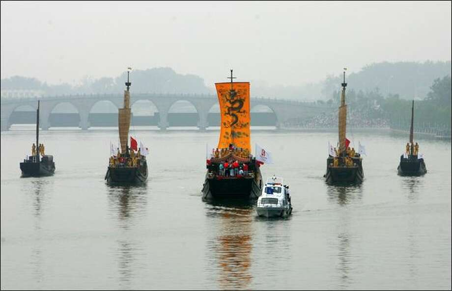 Olympic torch relay proceeds via classic imperial dragon boats on the Jing-Hang Grand Canal during the second day of the Beijing leg of Olympic torch relay on Thursday in Beijing, China. Photo: Getty Images / Getty Images