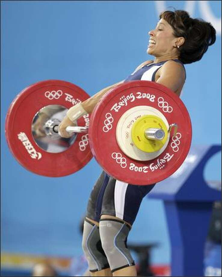 Melanie Roach, from Bonney Lake, lifts her way to an American record on Sunday.  She came in sixth overall in the women's 53 kg weightlifting event. Photo: Associated Press / Associated Press