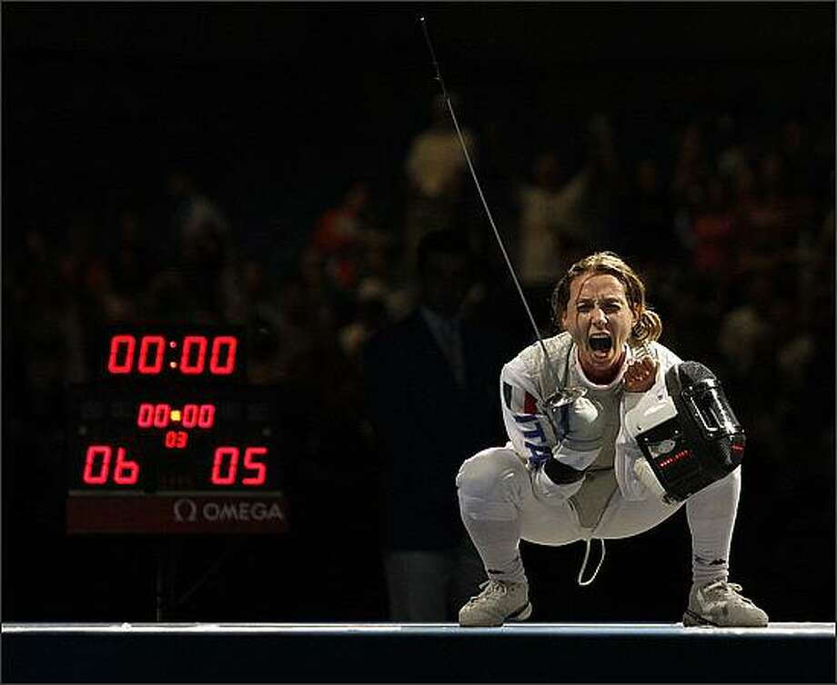 Italy's Valentina Vezzali reacts after defeating Korea's Nam Hyunhee in the gold medal competition in the women's individual foil fencing event at the 2008 Olympics in Beijing. Vezzali won the gold. (AP Photo/Elaine Thompson)