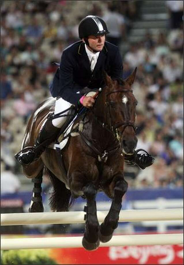 Clayton Fredericks of Australia and Ben Along Time jump in the Team Final and Individual Qualifying Show Jumping section of the equestrian competiton held at the Hong Kong Olympic Equestrian Venue in Sha Tin during Day 4 of the Beijing 2008 Olympic Games on Tuesday in Hong Kong, China. Photo: Getty Images / Getty Images