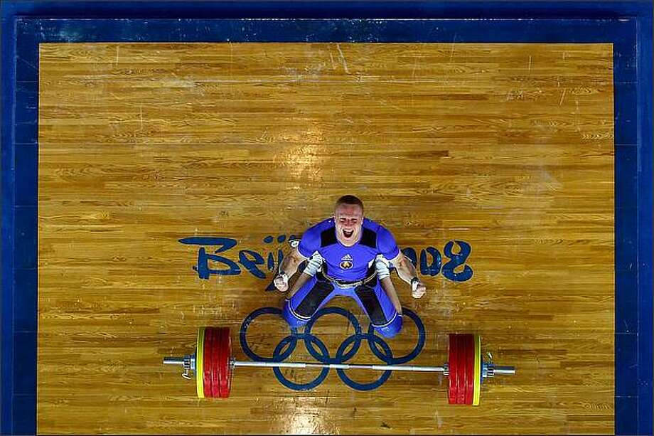 Andrei Rybakou of Belarus celebrates after he completes a successful lift in the men's 85kg weightlifting event at the Beijing University of Aeronautics & Astronautics Gymnasium on Day 7 of the Beijing 2008 Olympic Games in Beijing, China. (Photo by Cameron Spencer/Getty Images)