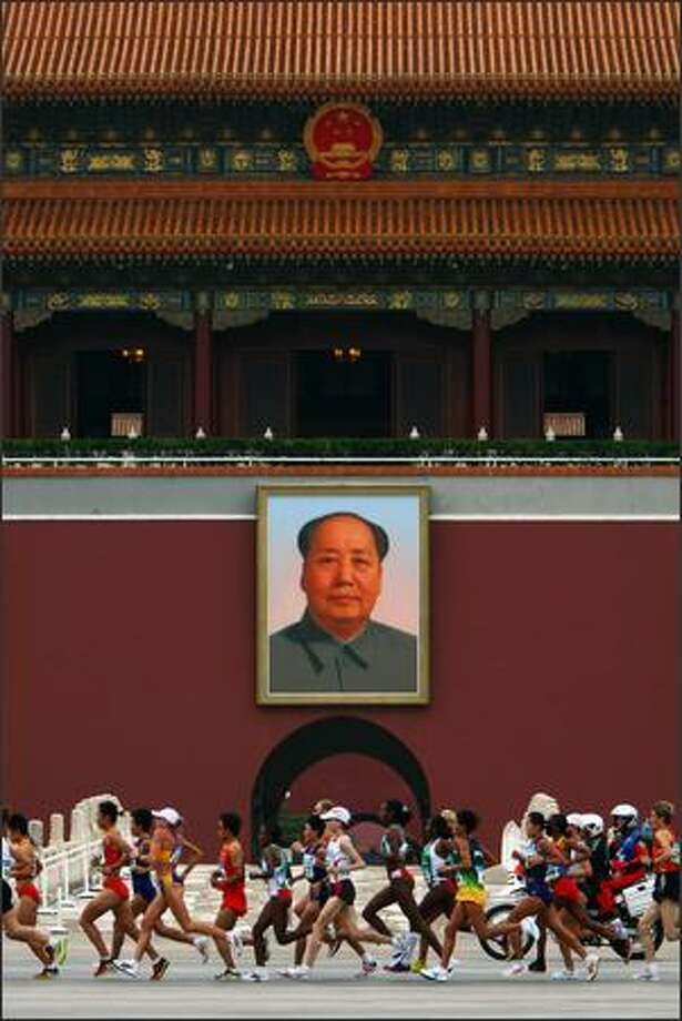 Athletes compete in the Womens Marathon as they run past Chairman Mao's portrait at Gate of Heavenly Peace, Entrance to the Forbidden City, on Day 9 of the Beijing 2008 Olympic Games on Sunday. Photo: Getty Images / Getty Images