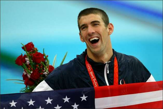 Michael Phelps wearing his eighth gold medal -- a new record -- after the men's 4x100 medley relay at the National Aquatics Centre during Day 9 of the Beijing 2008 Olympic Games. Photo: Getty Images / Getty Images