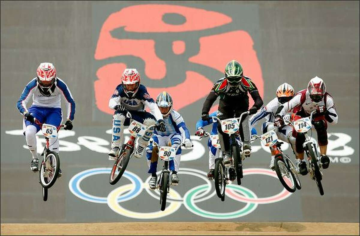 The second heat of the Men's Quarterfinals phase of the BMX competition including Kyle Bennett of the United States and Liam Phillips of Great Britain compete at the Laoshan Bicycle Moto Cross (BMX) Venue during Day 12 of the Beijing 2008 Olympic Games on Wednesday.