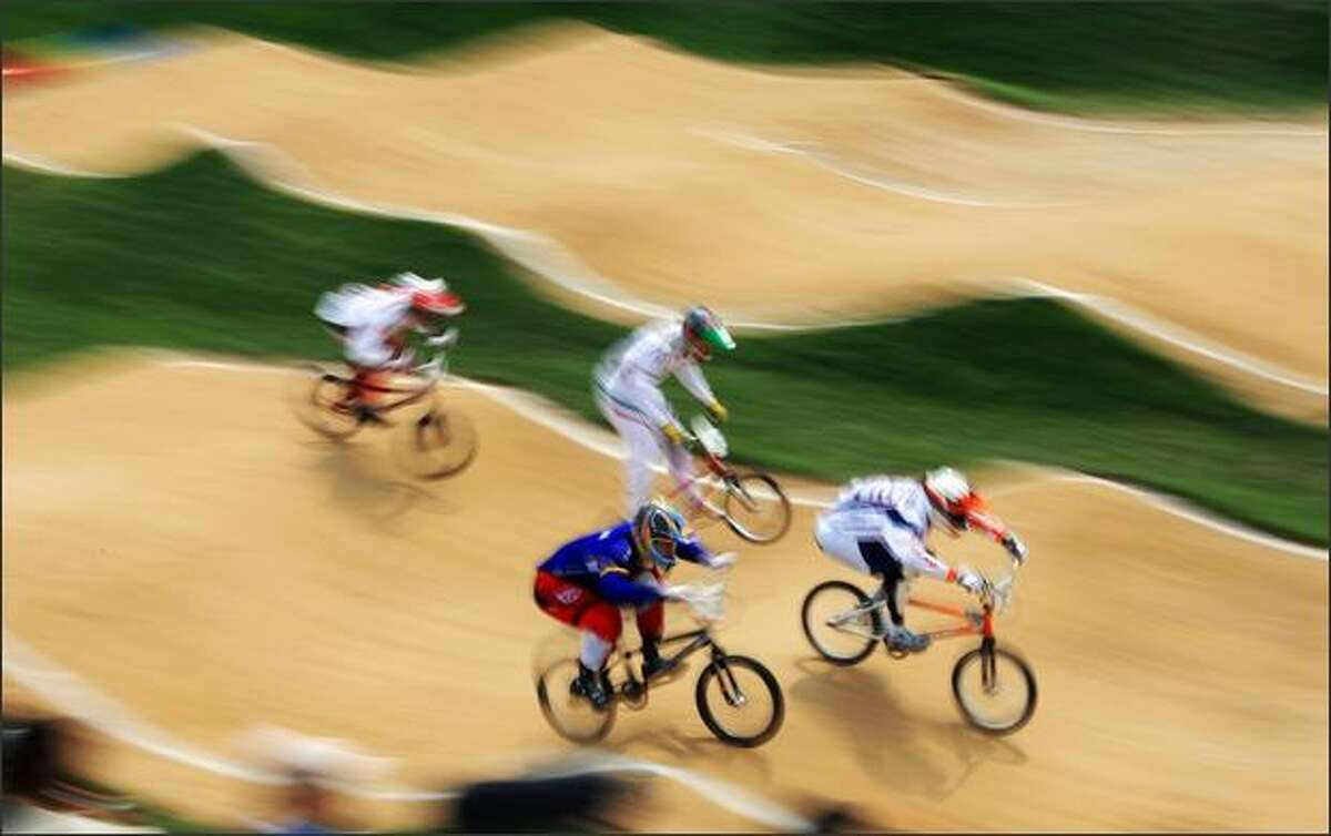 Riders compete in the men's BMX quarterfinals of the 2008 Beijing Olympic Games at the Laoshan BMX Venue, in Beijing on Wednesday.