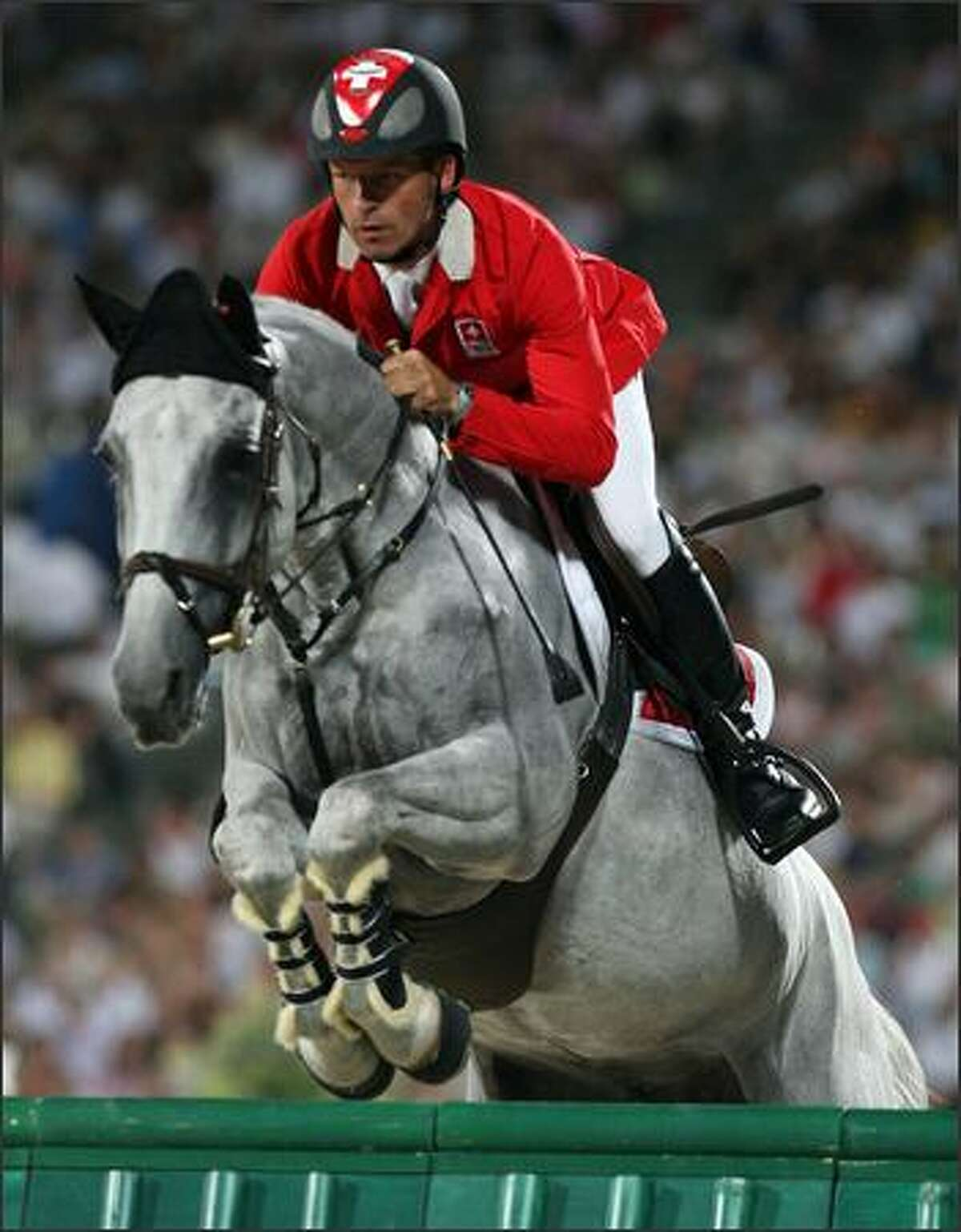 Pius Schwizer of Switzerland and Nobless M jump a fence during the Individual Jumping Final - Round A held at the Hong Kong Olympic Equestrian Venue in Sha Tin during day 13 of the Beijing 2008 Olympic Games on Thursday in Hong Kong.