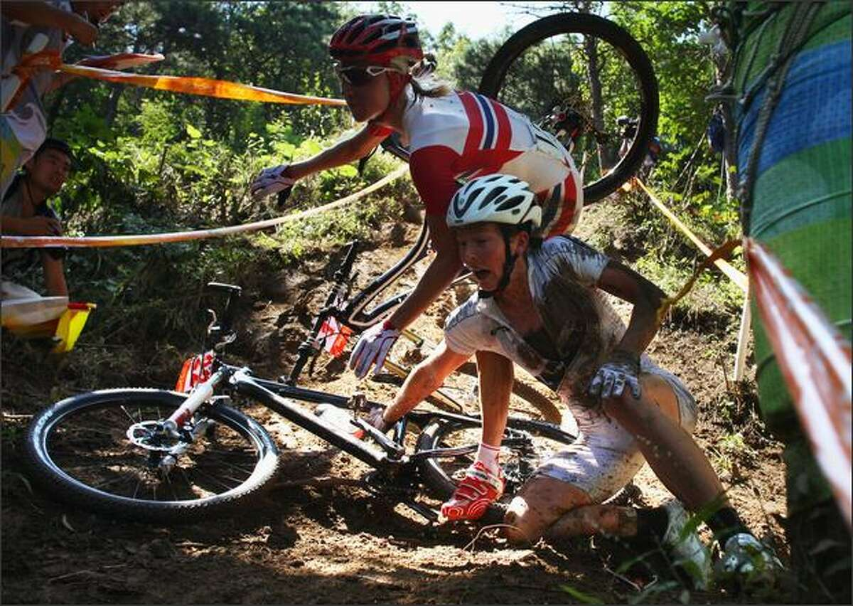 BEIJING - AUGUST 23: (L-R) Lene Byberg of Norway crashes into Rosara Joseph of New Zealand in the Women's Cross Country mountain bike cycling event held at the Laoshan Mountain Bike Course on Day 15 of the Beijing 2008 Olympic Games on August 23, 2008 in Beijing, China.