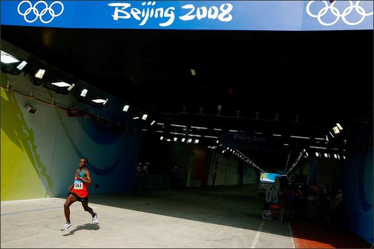 Samuel Kamau Wansiru of Kenya enters the National Stadium on his way to winning the Men's Marathon during Day 16 of the Beijing 2008 Olympic Games on Sunday in Beijing.