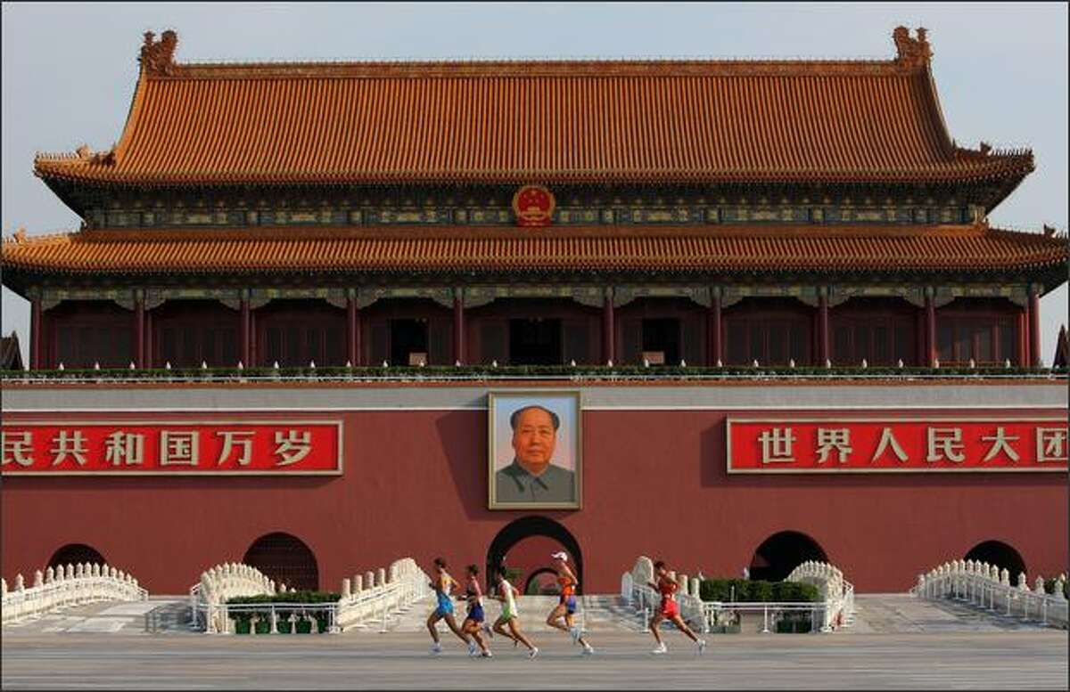 A general view of runners passing through Tianamen Square during the Men's Marathon held at the National Stadium during Day 16 of the Beijing 2008 Olympic Games on Sunday in Beijing.