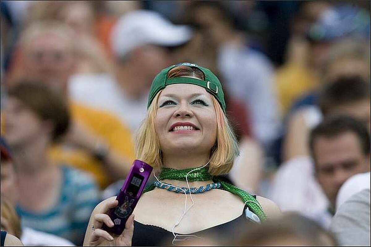 With her Seahawk colors in place, an iPod for tunes and her phone for photos and communication, this fan is ready for the game.