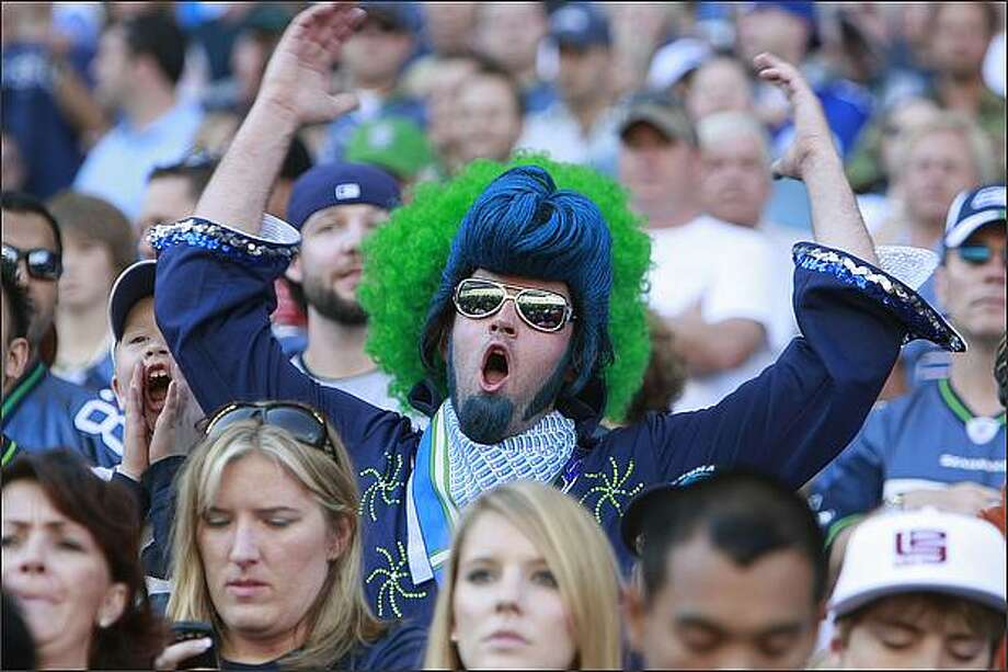 Elvis tries to get everyone to cheer during the second quarter as the Seahawks play the 49ers. Photo: Meryl Schenker, Seattle Post-Intelligencer / Seattle Post-Intelligencer