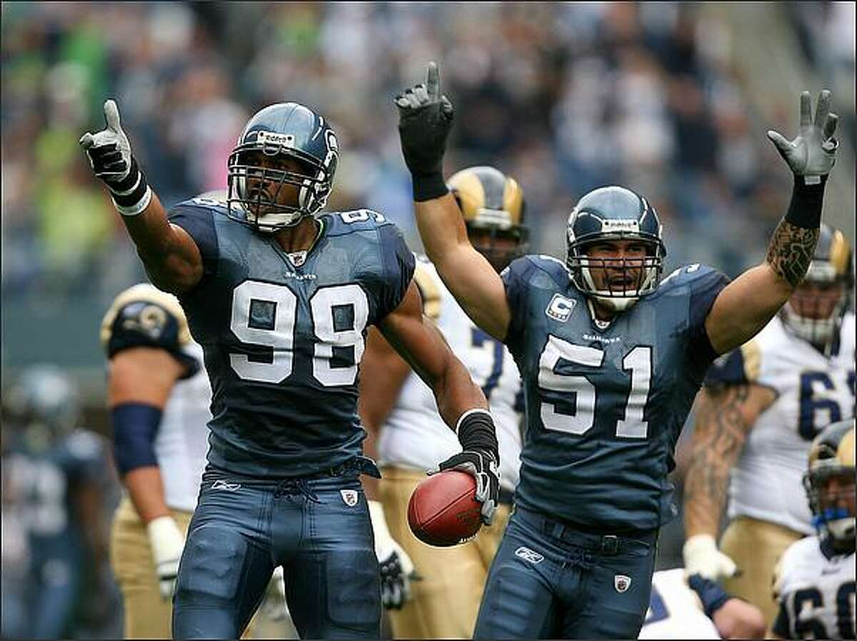 Julian Peterson (98) celebrates a sack and forced fumble and recovery with Lofa Tatupu which led to the Seahawks' first touchdown in the first quarter.