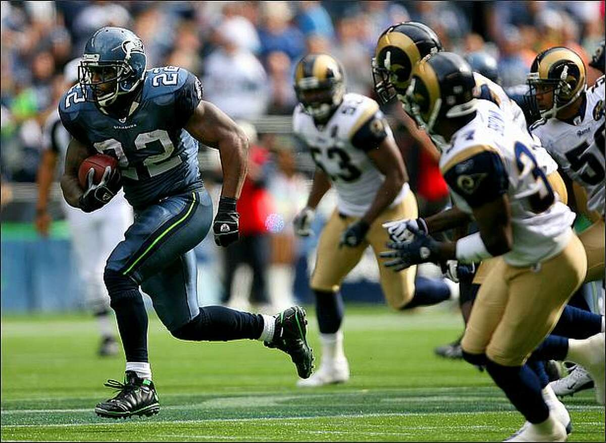 Julius Jones breaks off a 33-yard run at the end of the first half to set up a Seahawks field goal as the St. Louis Rams play the Seattle Seahawks at Qwest Field.