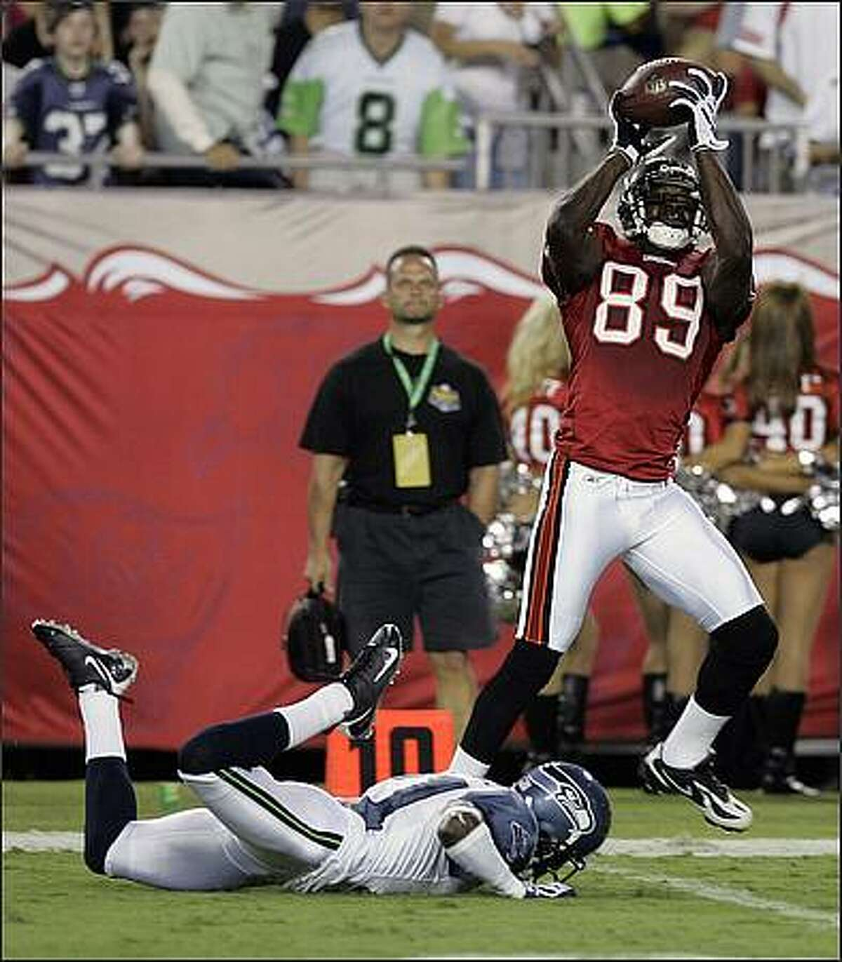 Tampa Bay Buccaneers wide receiver Antonio Bryant catches a 47-yard touchdown pass in front of Seattle Seahawks cornerback Kelly Jennings during the first half.