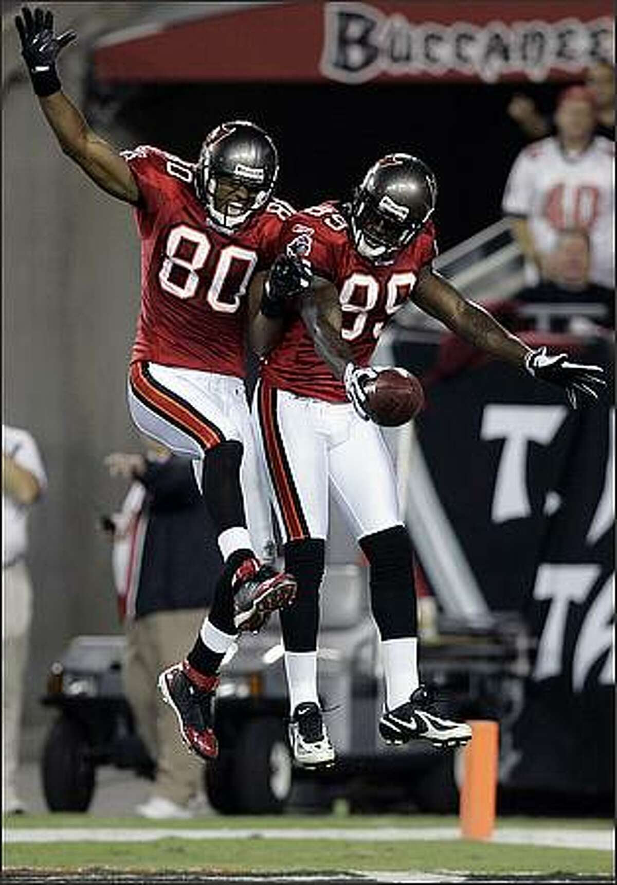 Tampa Bay Buccaneers wide receiver Antonio Bryant, right, celebrates with teammate Tampa Bay Buccaneers wide receiver Michael Clayton after Bryant scored on a 47-yard touchdown pass during the first half against the Seattle Seahawks in Tampa, Fla.
