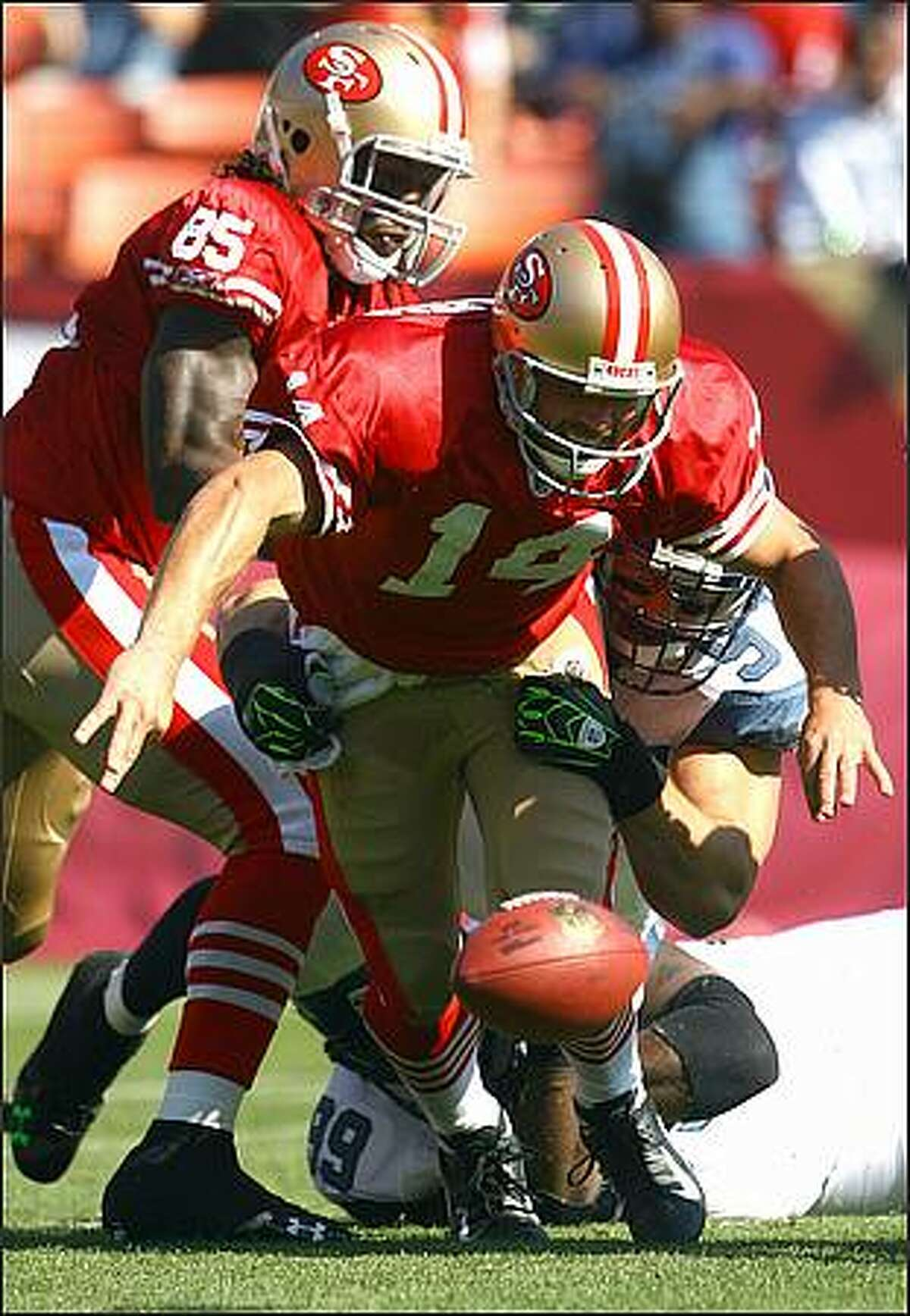 Quarterback J.T. O'Sullivan of the San Francisco 49ers fumbles the ball in the first quarter against the Seattle Seahawks at Candlestick Park.(Photo by Jeff Gross/Getty Images)