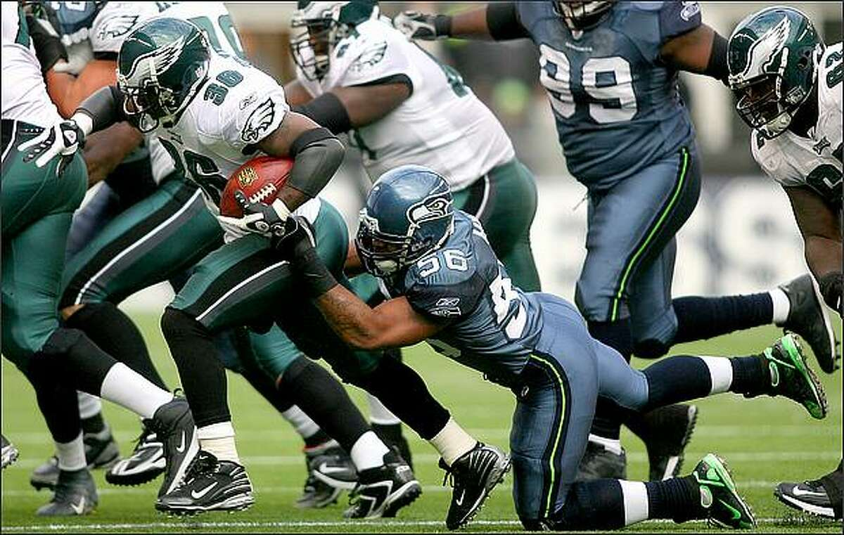 Seattle linebacker Leroy Hill brings down Philadelphia running back Brian Westbrook for a one-yard loss in the second quarter.