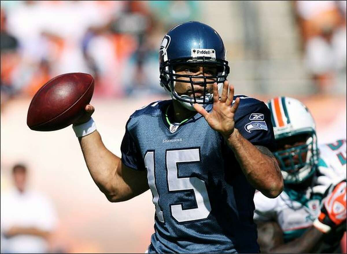 Quarterback Seneca Wallace #15 of the Seattle Seahawks throws a pass against the Miami Dolphins at Dolphin Stadium on Sunday in Miami, Florida.