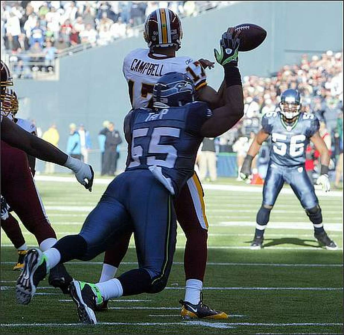 Seattle Seahawks defensive end Darryl Tapp drops Washington Redskins quarterback Jason Campbell for a five yard loss and forces a fumble during the first quarter at Qwest Field.