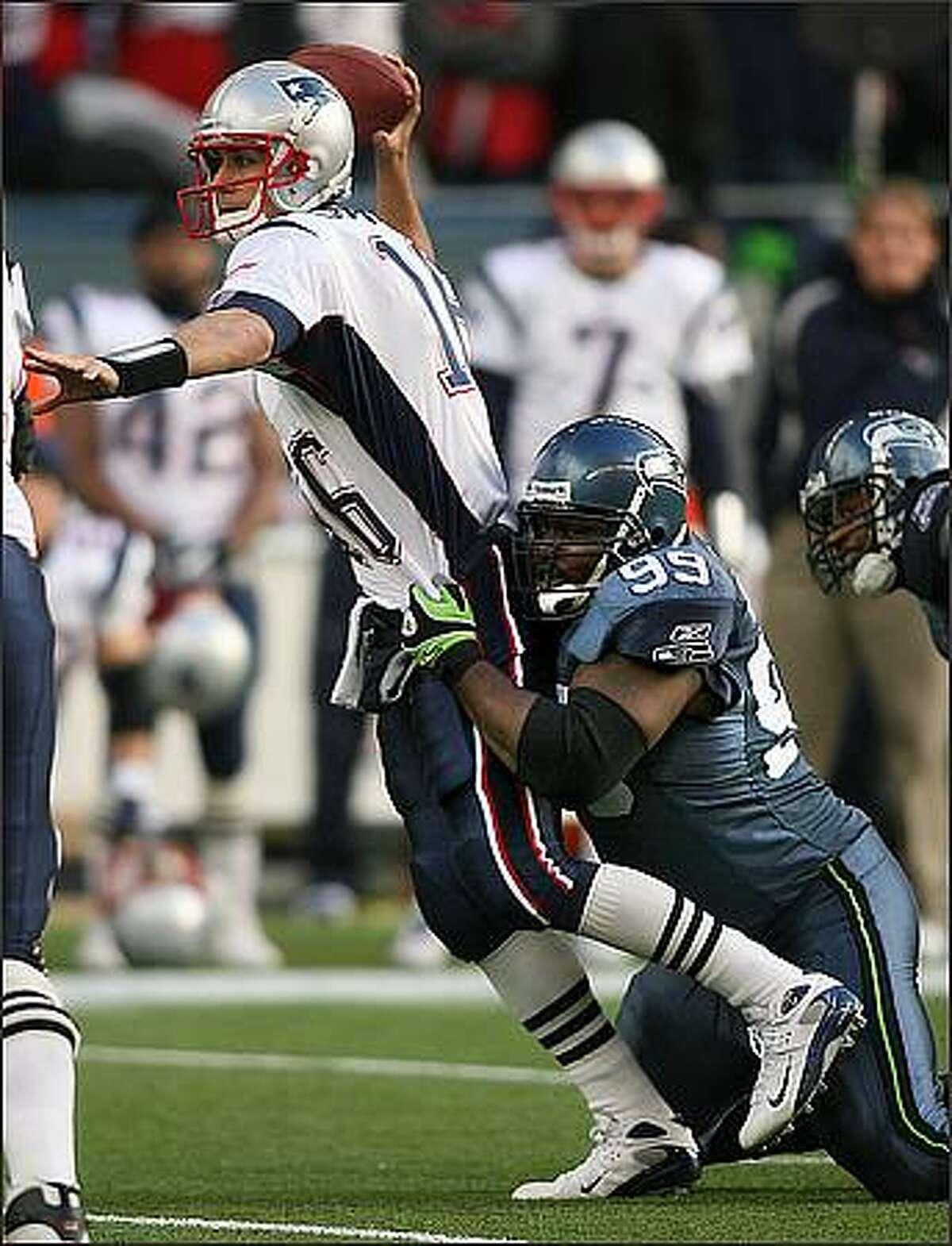 Seattle's Rocky Bernard applies pressure to Patriots quarterback Matt Cassell as he forces an incomplete pass in the second quarter.