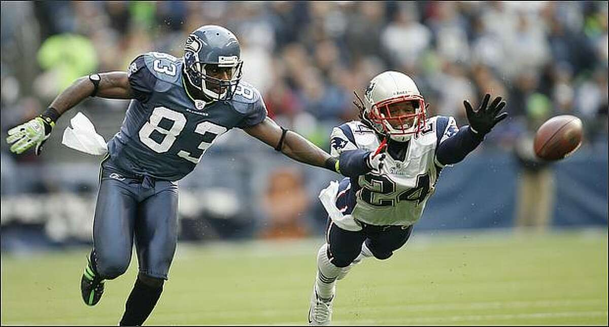 Seattle Seahawks wide receiver Deion Branch and New England Patriots cornerback Jonathan Wilhite are unable to come with a long pass by quarterback Seneca Wallace in the 2nd quarter.