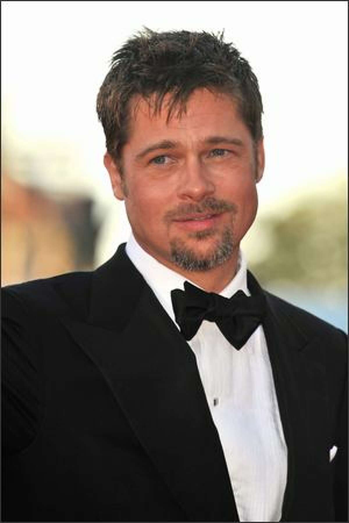 Actor Brad Pitt arrives at the opening ceremony and