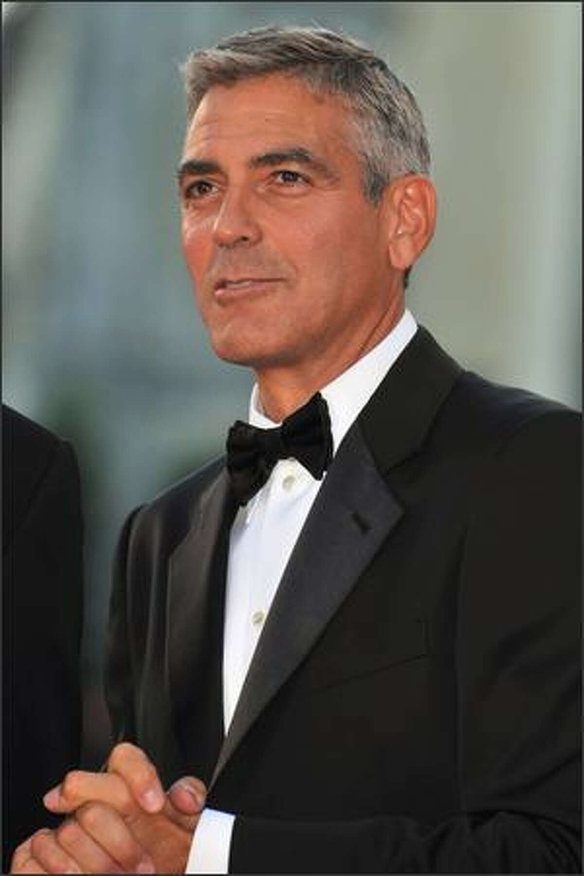 Actor George Clooney arrives at the opening ceremony and