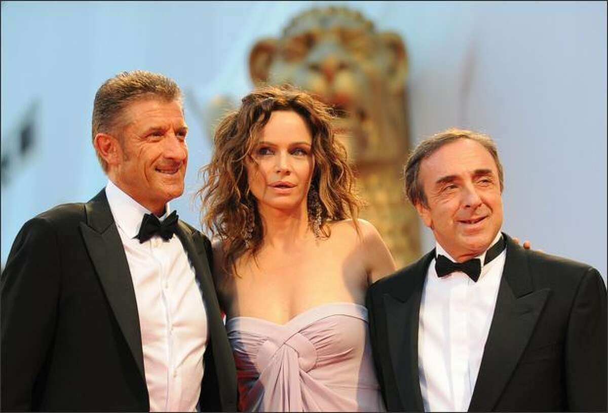 Italy's actress Francesca Neri poses with Italy's actor Ezio Greggio and Silvio Orlando, right, before the screening of the movie