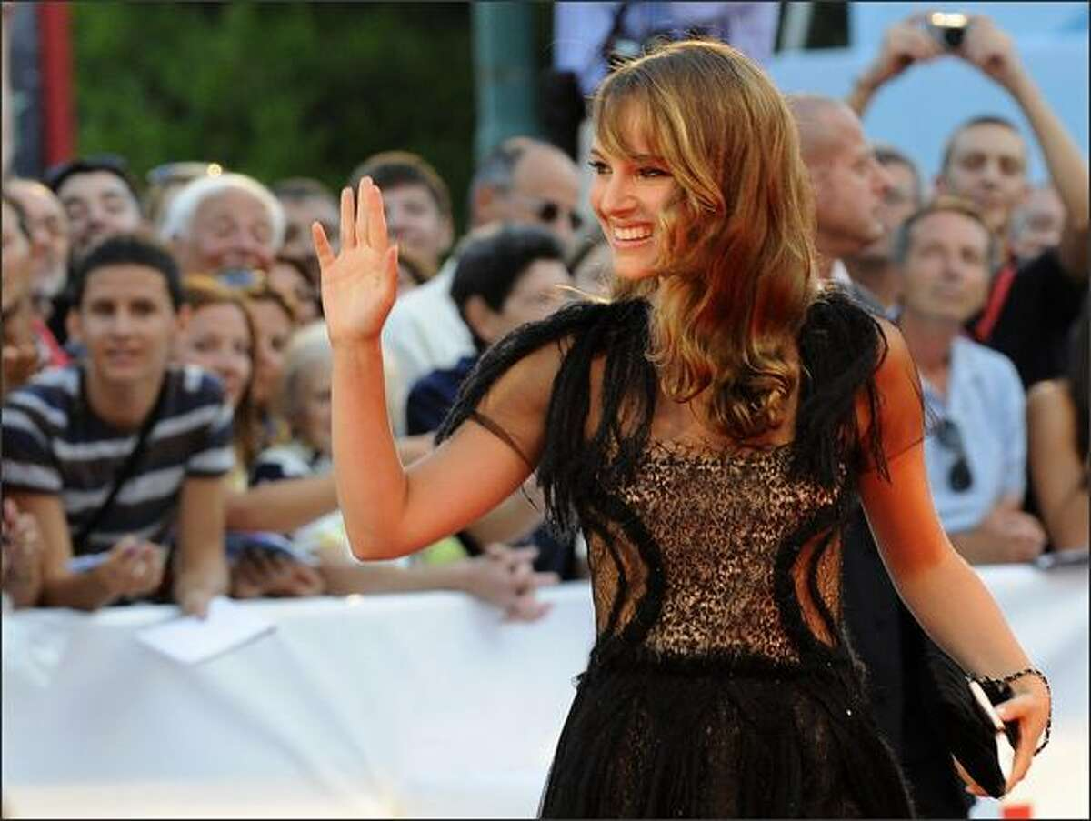 """Film star Natalie Portman waves to photographers as she arrives before the screening of """"Birdwatchers"""" during the 65th Venice International Film Festival at Venice Lido, on Monday. Natalie Portman's directorial debut """"Eve"""" opens the Corto Cortissimo section, the international competition of Short Films."""