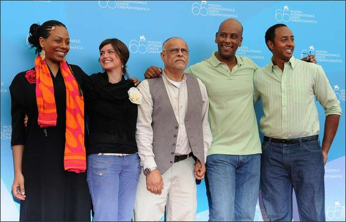 """Etiopia's director Haile Gerima, center poses with actors, from left, Evelyn Arthur Johnson, Veronika Avraham, Aaron Arefe and Abeye Tedla during the photocall of the movie """"Teza"""" during the 65th Venice International Film Festival at Venice Lido, on Tuesday. """"Teza"""" is presented in competition for the Golden Lion Award."""