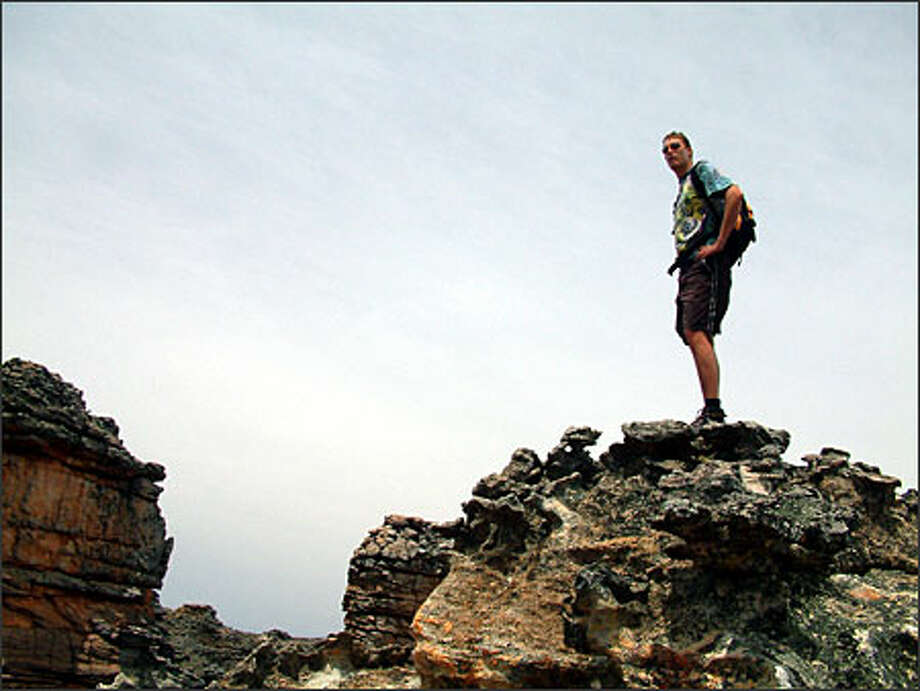 Paul de Goede (a South African who previously lived in Seattle) hikes through the moonscape terrain of the Cederberg Wilderness, north of Cape Town. Photo: Winda Benedetti, Special To Seattle Post-Intelligencer / Special to Seattle Post-Intelligencer
