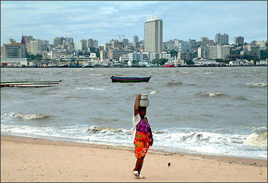 Maputo is the capital of Mozambique and the country's main seaport. My husband and I also found it to be a vibrant city with bustling streets and a thriving nightlife. From across the bay, it's hard to tell that Maputo is still recovering from the ravages of war and poverty. Photo: Winda Benedetti, Special To Seattle Post-Intelligencer / Special to Seattle Post-Intelligencer