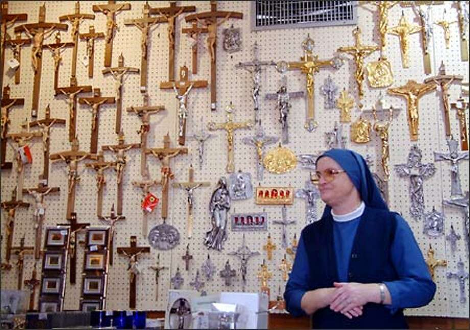 A nun sells religious items in a shop near the top of Saint Peter's Basilica in the Vatican City. St. Peter's Basilica is the epicenter of Roman Catholic worship. Photo: Winda Benedetti, Special To Seattle Post-Intelligencer / Special to Seattle Post-Intelligencer