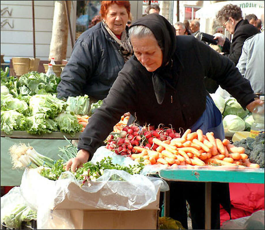 A woman sells vegetables at the open air market in Split, the second-largest city in Croatia (and the place I enjoyed visiting the most in this country). Photo: Winda Benedetti, Special To Seattle Post-Intelligencer / Special to Seattle Post-Intelligencer