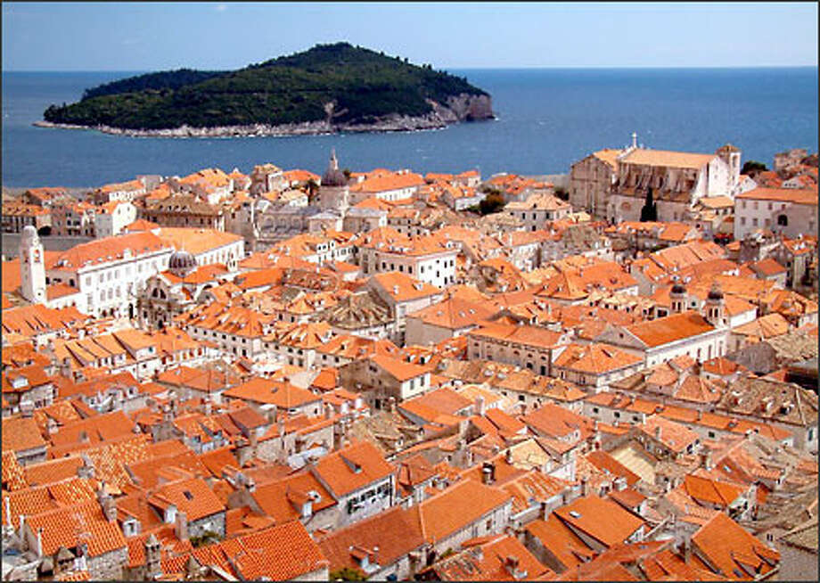 Although the old city of Dubrovnik dates back to medieval times and was declared a World Heritage Site in 1979, this historic place took a serious beating in 1991 and 1992 when Serbian militias laid siege to the port town. If you look carefully at the sea of rooftops pictured here, you can see that many of the tiles are new (brighter orange) compared to the faded brown color of the older tiles. That's because nearly 70 percent of these buildings were damaged by shelling. Although a few buildings on the outskirts remain in ruins, most of the old city has been carefully restored. Photo: Winda Benedetti, Special To Seattle Post-Intelligencer / Special to Seattle Post-Intelligencer