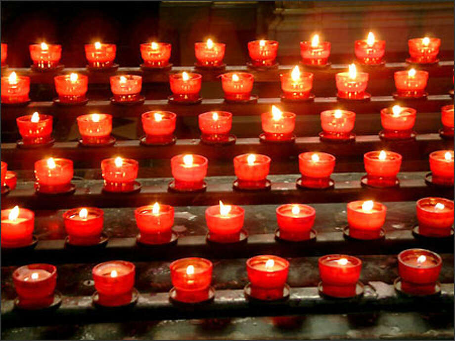 Votive candles at St. Stephen's Basilica in Budapest. Photo: Winda Benedetti, Special To Seattle Post-Intelligencer / Special to Seattle Post-Intelligencer