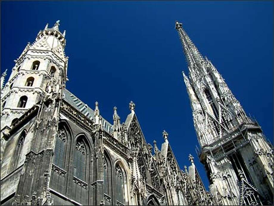 Vienna is a city of architectural wonder. One of the most imposing structures is the Gothic St. Stephan's Basilica with its 370-foot steeple and a basement stacked high with the bones of plague victims. Photo: Winda Benedetti, Special To Seattle Post-Intelligencer / Special to Seattle Post-Intelligencer