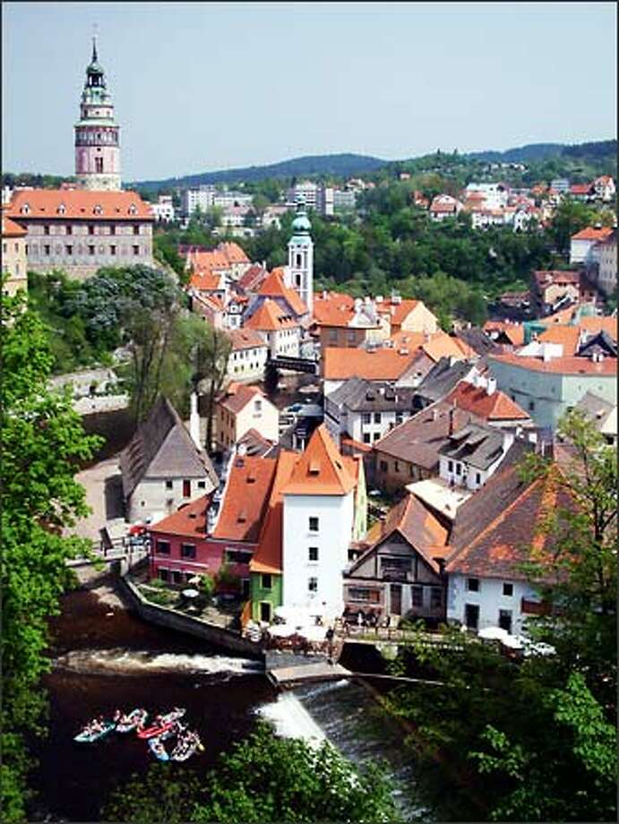 Krumlov Castle and its painted tower loom large over the preposterously cute town of Cesky Krumlov, located in the South Bohemia region of the Czech Republic. The Vltava River (a popular rafting destination) curves its way through a town that has remained surprisingly unchanged during the last several hundred years. Photo: Winda Benedetti, Special To Seattle Post-Intelligencer / Special to Seattle Post-Intelligencer
