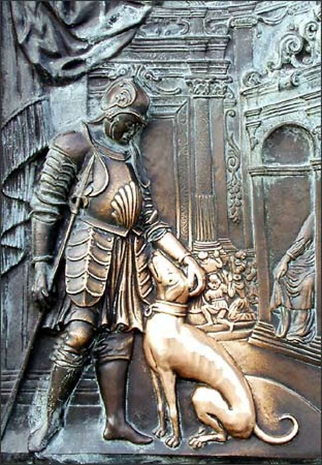 A relief on Charles Bridge rubbed shiny for luck. Photo: Winda Benedetti, Special To Seattle Post-Intelligencer / Special to Seattle Post-Intelligencer