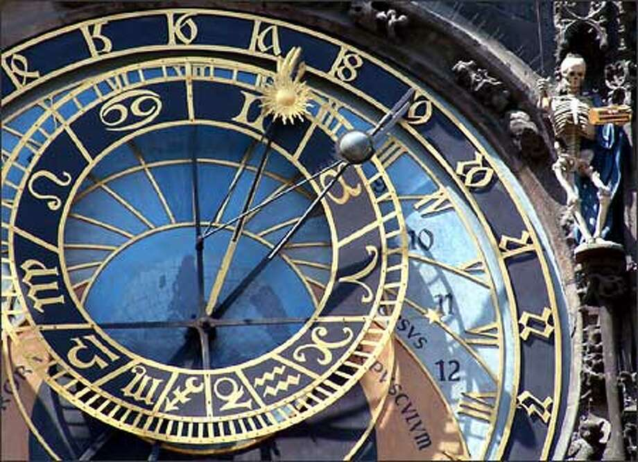 Death rings a knell on the hour at Prague's famed Astronomical Clock. Photo: Winda Benedetti, Special To Seattle Post-Intelligencer / Special to Seattle Post-Intelligencer