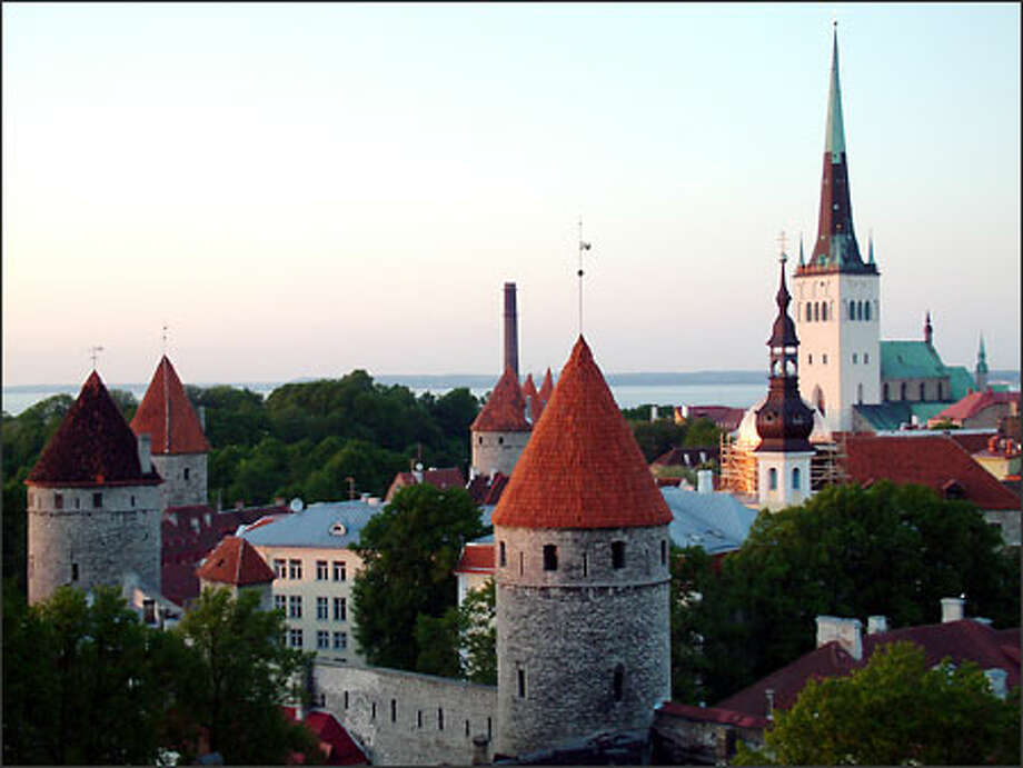 Tallinn looks like a city plucked from the past, what with its medieval guard towers, ancient fortification walls and 13th century St. Olav's Church spire. And, in fact, the old center of this Estonian capital was built between the 13th and 16th centuries. Still, for all its historic appeal, this thriving port town on the Baltic Sea is not simply stuck in days gone by. Tallinn also is a modern city with all the contemporary accoutrements: movie theaters, cyber cafes and plenty of shopping malls. Photo: Richie Costleigh, Special To Seattle Post-Intelligencer / Special to Seattle Post-Intelligencer